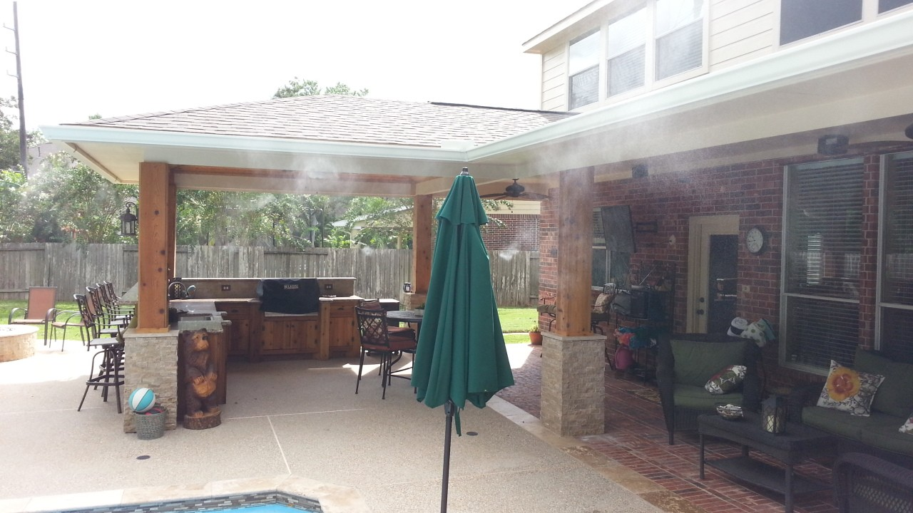 house with mosquito misting system spraying