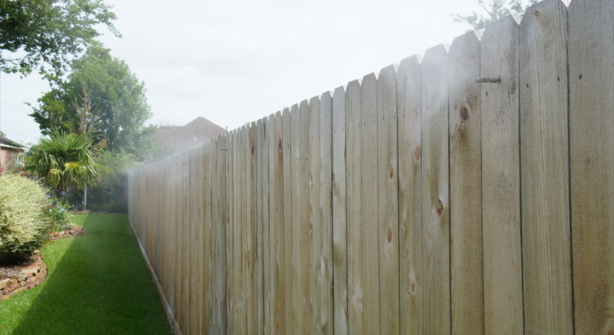 yard mosquito misting spraying fence